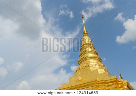 Golden pagoda and blue sky in Phra That Chae Haeng temple, nan province thailand