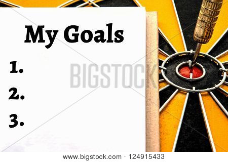 Words my goals and dart target arrow on bullseye with copy space