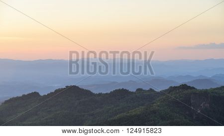 Sunset sky and misty layer mountain in sri nan national park thailand