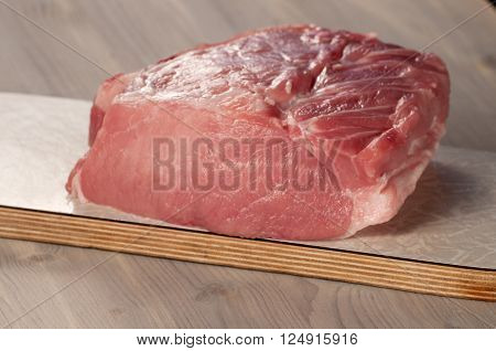 Pork loin on a timber board closeup