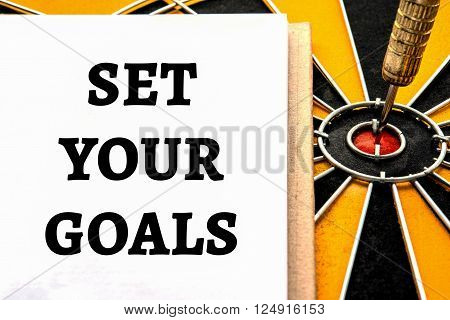 Words set your goals with dart target arrow on bullseye of dartboard Smart goal target success business investment financial strategy concept abstract background