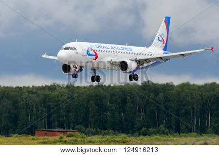 DOMODEDOVO RUSSIA - JULY 20: Aircraft operated by Ural Airlines landing at Moscow airport in Domodedovo on July 20 2013. The company in its fleet has 10 aircraft Airbus-A321