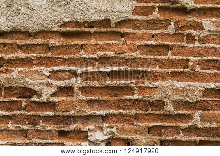 old rundown cracked brick wall background, texture