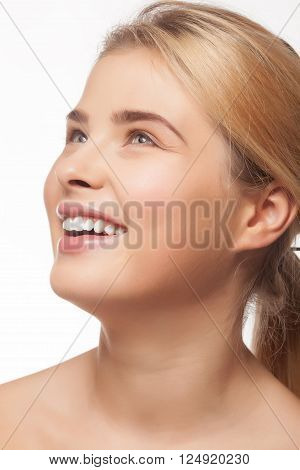 Girl With Very Large Smile Looking Up On White Background