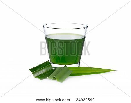 a glass of pandan juice with leaf on white background