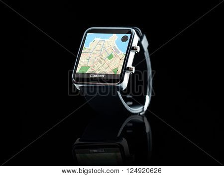 modern technology, object, application and navigation concept - close up of black smart watch with gps and road map on screen over black background