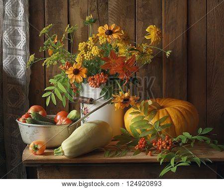 Still life with bouquet, pumpkin, tomatoes, cucumbers, peppers and zucchini on the table. Autumn still life, harvest.