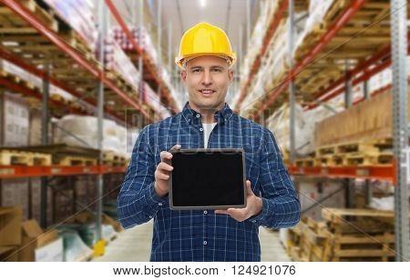 wholesale, logistic, business, export and people concept - happy man or manager showing tablet pc computer blank screen over warehouse background