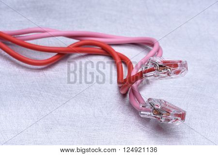 Closeup of a electric cables on metalic grey background