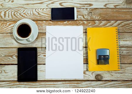 Business desk with equipment, digital tablet, phone, stamp. Office table top view