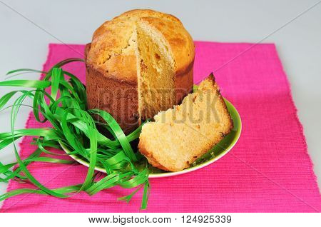 Traditional easter yeast cake covered with white icing and raisins Spongy yeast cake that is traditionally baked for Easter Sunday in Poland Belarus Ukraine Russia.