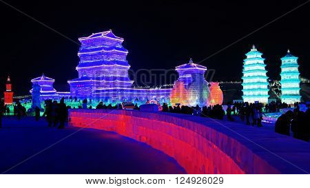 HARBIN CHINA - JANUARY 16 2016: colorful ice structures at night during the 32nd Harbin Ice Festival. The main attraction is the Harbin Ice and Snow World which covers more than 750000 square meters.