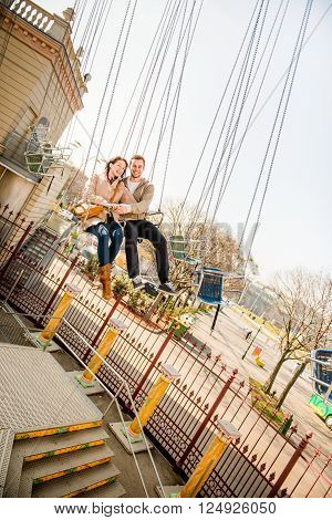 Vienna, Prater - couple dating and riding on merry go round