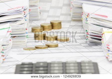 Step Gold Coins Have Blur Calculator Between Pile Of Paperwork