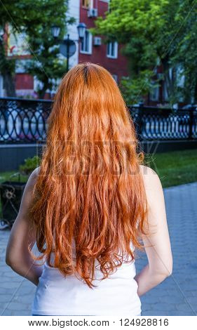 Rear view of redhair women posing outdoors
