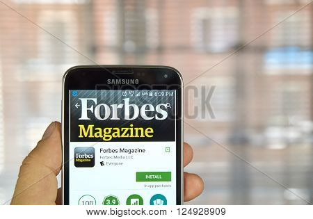 MONTREAL CANADA - MARCH 20 2016 - Forbes Magazine application on Samsung S5's screen. Forbes is an American business magazine published bi-weekly.