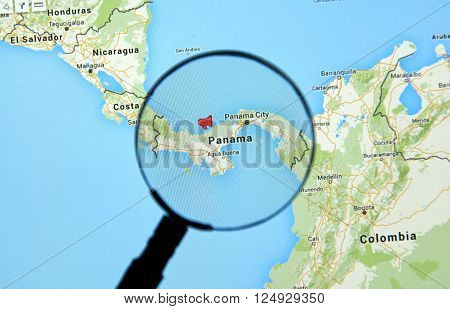 MONTREAL CANADA - APRIL 7 2016 : Panama on a map with mouthpiece icon under magnifying glass. Panama is a well known country for it's recent documents leak called The Panama Papers.