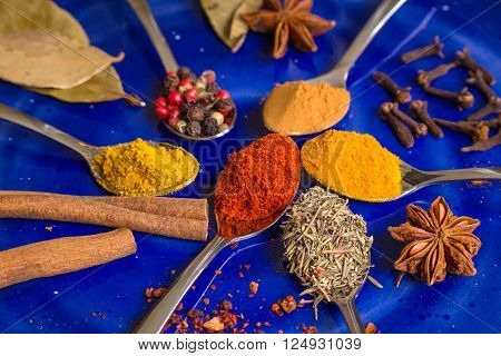 Different Colorful Spices On Dark Blue Background