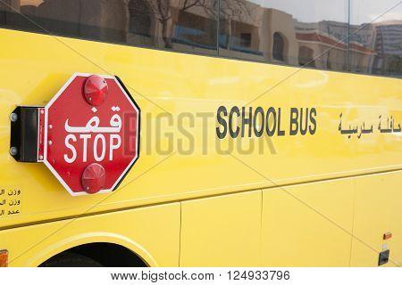 DUBAI UAE - APRIL 4: A close-up view of a yellow Arabic school bus on April 4 2016 in Dubai UAE.