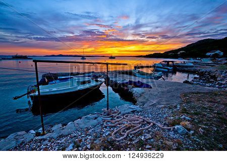 Idyllic sunset in old fishermen harbor Drage Croatia
