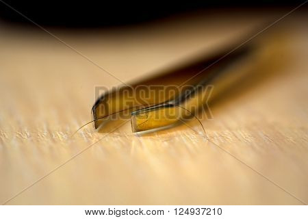 Cosmetics Tweezers On Table