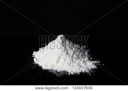 Heap of heroin on the black background