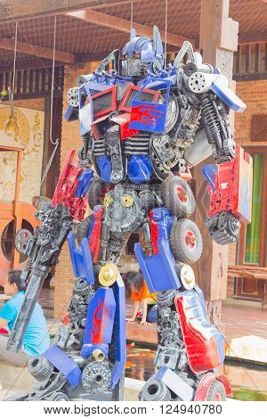 ANG THONG, THAILAND - APRIL 3 :  The Optimus Prime robot made of remnant of iron on April 3, 2016 in Ang Thong, Thailand. Optimus Prime is a character from the Transformers franchise