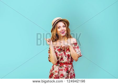 preety yong woman ( girl ) in hat smiling on blue background