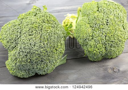 Fresh broccoli isolated on gray wooden background