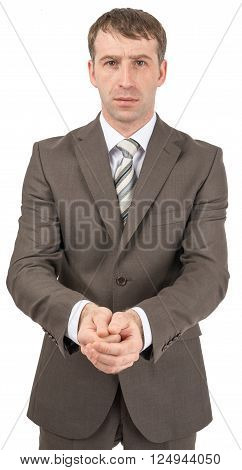 Unhappy businessman holding hands in front of him and looking at camera