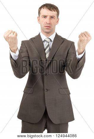 Unhappy businessman raised his hands up in front of him. Isolated on white background