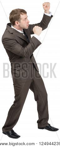 Businessman standing in fighting stock raising their fists up. Isolated on white background. Full length