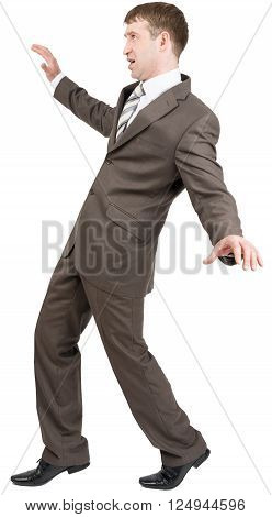 Businessman on tiptoes isolated on white background