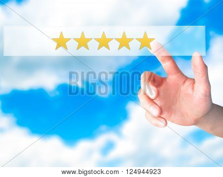 Five Star Rating - Hand Pressing A Button On Blurred Background Concept On Visual Screen.