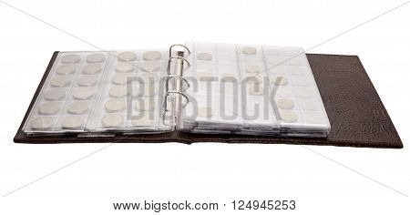 Open album for coins to cover the skin brown crocodile on a white background