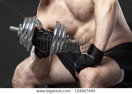 Muscular Yong Man Exercising With Dumbbell