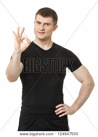 Positive Fit Young Man Showing Ok Sign Isolated On White.