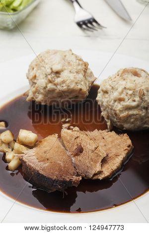 portion of bavarian roasted pork with dumplings