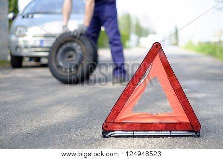 Vehicle breakdown red triangle road danger symbol