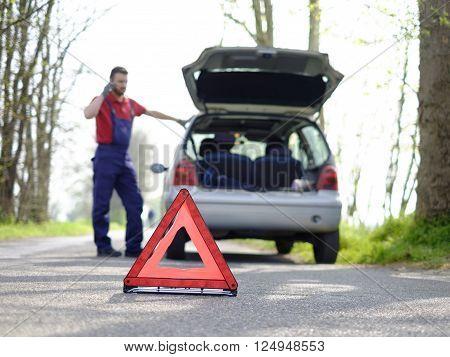 mechanic reapair breakdown vehicle on the road