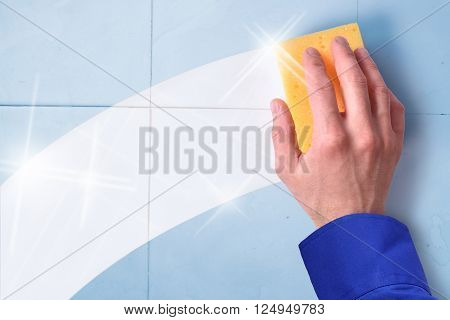 Concept of professional cleaning employee with blue tiles background and clean trace