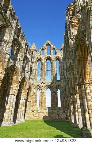 Ruined inner walls to Whitby Abbey in North Yorkshire in England. It is ruins of the Benedictine abbey. Now it is under protection of the English Heritage.