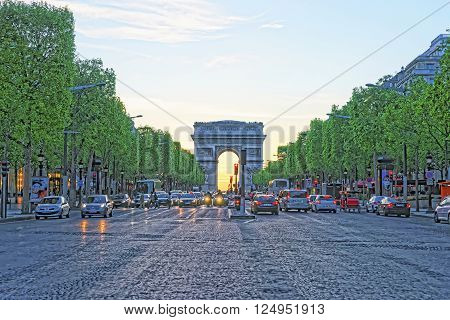 PARIS FRANCE - MAY 3 2012: Triumphal Arch of the Star in Paris in France at sunset. The Arc de Triomphe de Etoile is one of the most known monuments in Paris