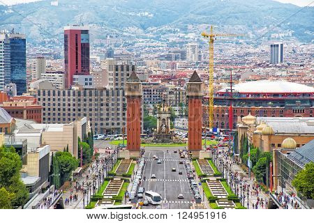 Venetian towers on Plaza de Espana on Montjuic in Barcelona in Spain. Placa Espanya is one of the most important and well-known squares in Barcelona. It is placed at the foot of Montjuic mountain.