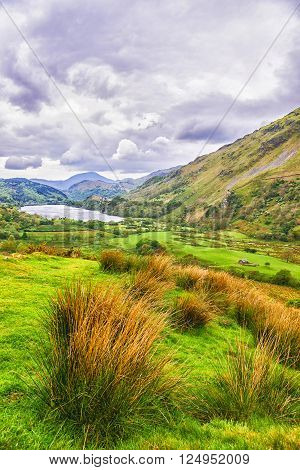 View to a mountain lake in Snowdonia National Park in North Wales of the United Kingdom. Snowdonia is a mountain range and a region in North of Wales.