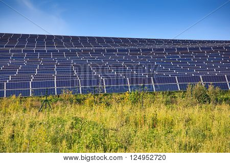 View of solar panels of photovoltaic modules for renewable energy in the Sicily countryside