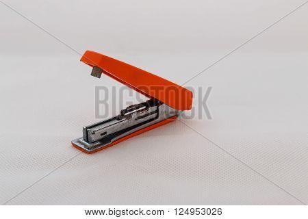 Max stapler with orange old on white background