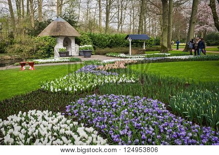 LISSE, SOUTH HOLLAND/ THE NETHERLANDS - APRIL 2, 2016: Corner with gazebo of the Keukenhof garden , one of the world's largest flower gardens, in the first days after opening in 2016