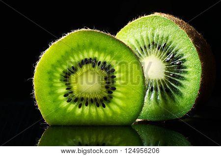 cut of kiwi fruit on black background horizontal format