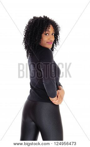 A pretty and slim African American woman in black tights and sweater